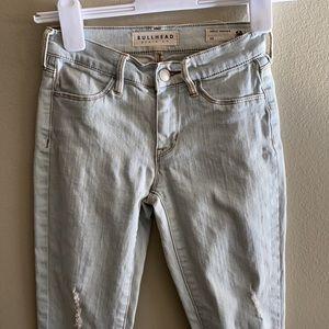 Distressed bullhead jeans